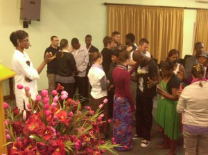 Pastor and service while ministry team prays for people.